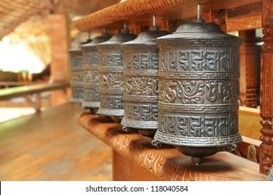 Tibetan prayer wheels in Buddhism temple