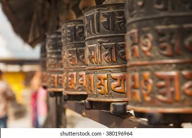 Tibetan prayer wheels or prayer's rolls of the faithful Buddhists.