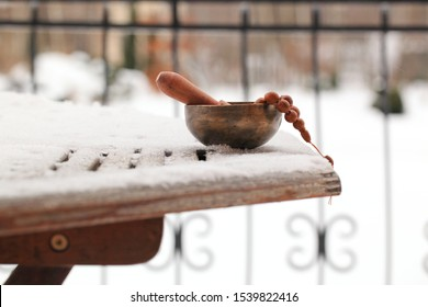 Tibetan singing bowl with its hammer on wooden table, close-up. - winter Image