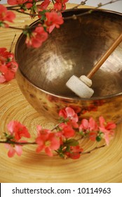 Tibetan singing bowl with mallet and japanese cherry flowers