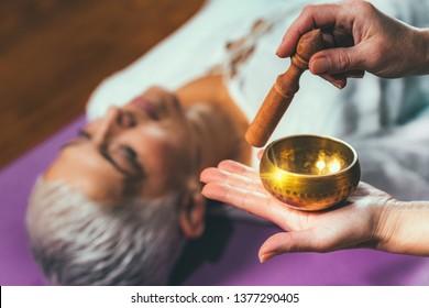 Tibetan singing bowl in sound meditation therapy