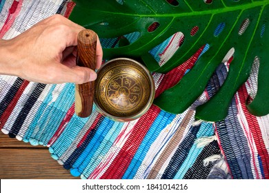 """Tibetan singing bowl with stick. Tibetian inscription - mantra """"Om mani padme hum""""(Om is a sacred syllable. Mani means """"jewel"""", Padme is the """"lotus flower"""", and Hum represents spirit of enlighment)"""