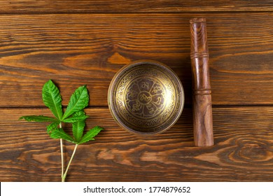 "Tibetan singing bowl. Tibetian inscription - mantra ""Om mani padme hum""(Omis a sacred syllable. Mani means ""jewel"", Padmeis the ""lotus flower"", andHumrepresents spirit of enlighment)"