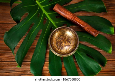 """Tibetan singing bowl. Tibetian inscription - mantra """"Om mani padme hum""""(Om is a sacred syllable. Mani means """"jewel"""", Padme is the """"lotus flower"""", and Hum represents spirit of enlighment)"""