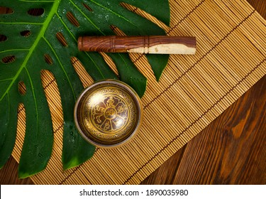 """Tibetan singing bowl. Tibetian inscription - mantra """"Om mani padme hum"""" (Om is a sacred syllable. Mani means """"jewel"""", Padme is the """"lotus flower"""", and Hum represents spirit of enlighment)"""