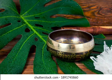"""Tibetan singing bowl. Tibetian inscription - mantra """"Om mani padme hum"""" (Om is a sacred syllable. Mani means """"jewel"""", Padme is the """"lotus flower"""", and Hum represents spirit of enlighment)."""