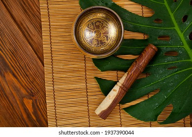 """Tibetan singing bowl. Tibetian inscription - mantra """"Om mani padme hum"""" (""""Om"""" is a sacred syllable. """"Mani"""" means """"jewel"""", """"Padme"""" is the """"lotus flower"""", and """"Hum"""" represents spirit of enlighment)"""