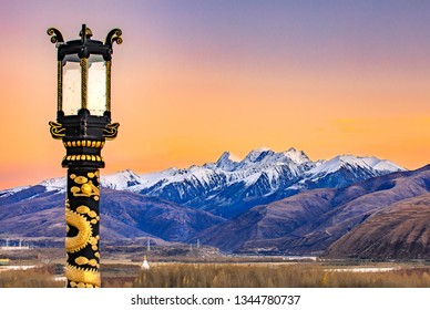 Tibetan Street Lamp and Snow Mountain Background at High Altitude, Tibet, China