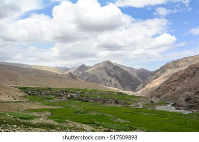 Tibetan village with green valley at sunny day in Leh, Ladakh, India. Ladakh is one of the most sparsely populated regions in Jammu and Kashmir. - Shutterstock ID 517509898