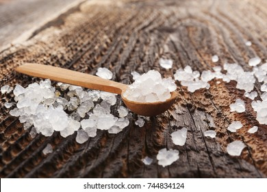 Tibi crystals on wooden spoons on dark wooden background. Natural healthy medicine.