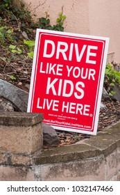 "TIBURON, CALIFORNIA - JANUARY 17, 2018: Sign with warning text ""Drive like your kids live here""  alerting all drivers to be alert for children playing."