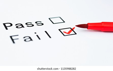 Tick boxes for Pass or Fail on paper with pen.