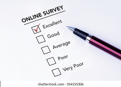 Tick placed in excellent check box on online service satisfaction survey form with a pen on isolated white background. Business concept survey.