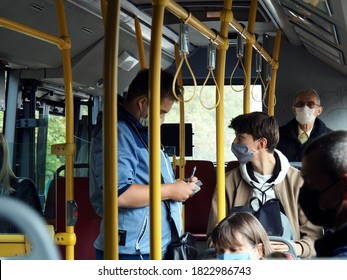 A ticket inspector/controller with mask issues a penalty note with fine to a passenger with mask in public bus transport, PRAGUE, CZECHIA/Czech Republic, Europe 09/27/2020