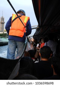 ticket taker wear life jacket and blue jeans is working on boat motion on canal at Bangkok, Thailand, 11 Jan 2018