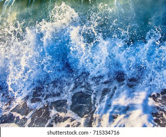 Tidal bore, pecky sea; surging sea; turbulent sea; ugly sea. Oceanic waves during storm. water roll forward, boils at shore, force of nature