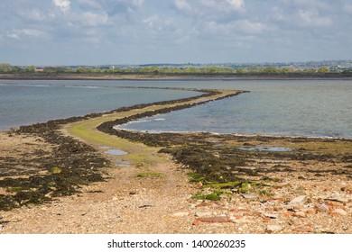 The tidal causeway to Osea island winds across the Blackwater Estuary