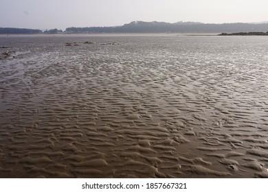 Tidal flat. mud in the tidal flats. Sunlight reflected on the tidal flat.