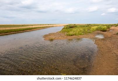 Tidal salt marsh lagoon on the North Norfolk coast, UK