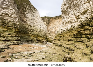 Tidal surge inlet cove in chalk cliffs at Flamborough Head, East Yorkshire, UK