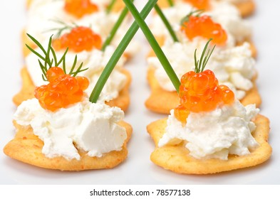 Tidbits with cream cheese and trout kaviar