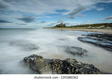 The tide coming in at Bamburgh Castle on the Northumberland Coast