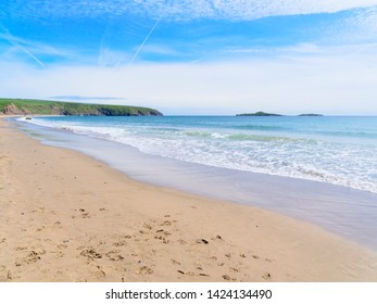 The tide goes out on an almost deserted Aberdaron beach in Wales