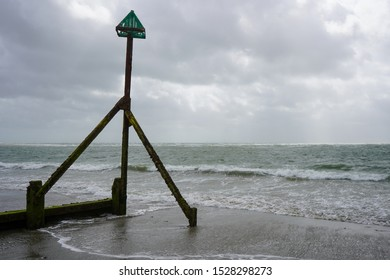 Tide Marker with the tide out and overcast sky