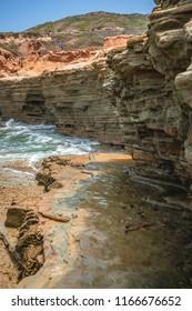Tide pools, cliffs and crashing waves.