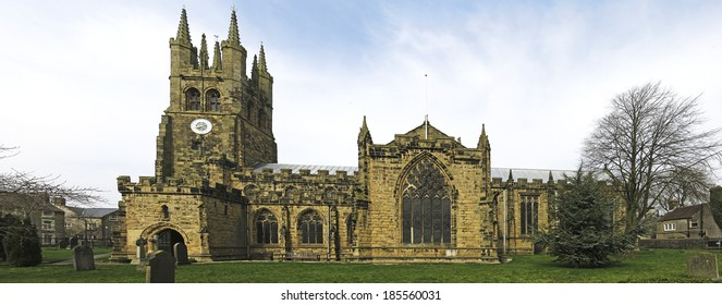 """TIDESWELL, UK - MARCH 2014: St John the Baptist, Tideswell, Peak District, 30 March 2014. The magnificent 14th century church is known as the """"Cathedral of the Peak""""."""