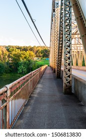 Tidioute, Pennsylvania, USA 9/14/2019 The Tidioute Bridge walkway which spans over the Allegheny River in Warren county at sunset in summer