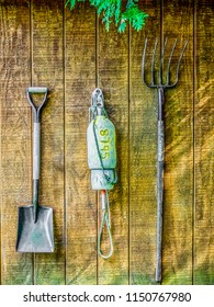 Tidy arrangement of farming tools displayed on a wooden wall