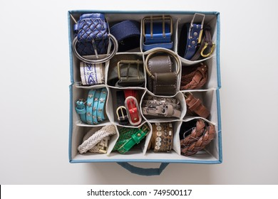 Tidy and organized woman belts with the konmari method