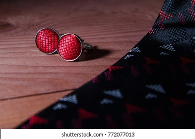 tie and cufflinks on the table