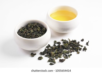 Tie Guan Yin tea dry and beverage in cup on white background. Traditional Chinese drink