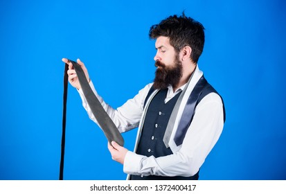 The tie is just the ticket for any menswear outfits. Bearded man choosing neck tie. Brutal hipster holding colorful tie collection. Find yourself a unique tie and mens accessories.