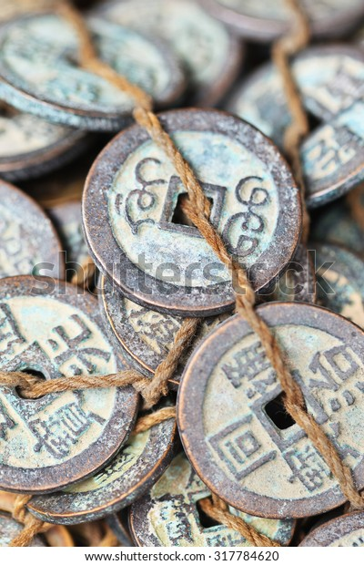 Tied antique Chinese coins on Panjiayuan Market, located in south east Beijing, China.