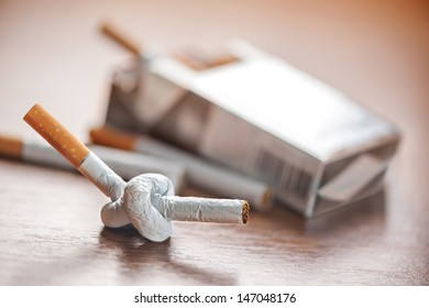 tied cigarette on table closeup