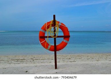 Tied lifebuoy located on the beach on the Indian ocean in the heart of the Maldives