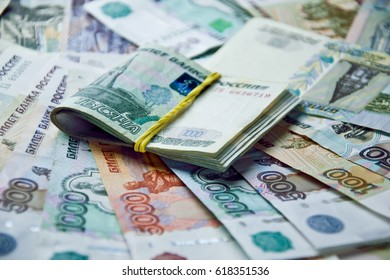 tied with a rubber band russian banknotes on money background