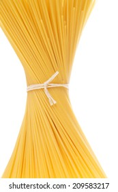tied together spaghetti over a white background / Pasta