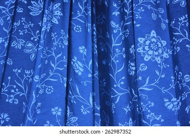 Tie-dye blue and white flower pattern curtain with wrinkles