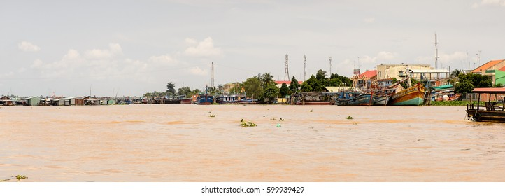TIEN GIANG PROVINCE, VIETNAM - OCT 5, 2014: Boats on the Mekong river in Southern Vietnam. Mekong is the 12th-longest river and flows trough China, Burma, Laos, Thailand, Cambodia, Vietnam