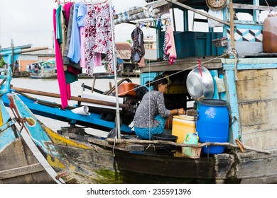 Tien Giang, Vietnam - Nov 28, 2014: Floating boat, the mobile house for people living in poverty on Tien river, Mekong delta