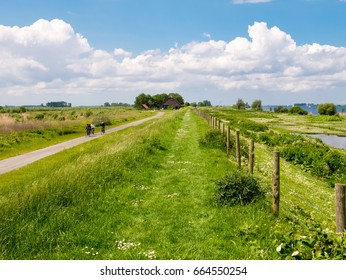 TIENGEMETEN, NETHERLANDS - MAY 20, 2017: People riding bicycle on cycle path on Tiengemeten island in Haringvliet estuary, South Holland, Netherlands