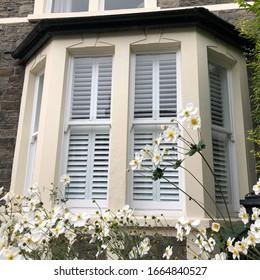 Tier on tier shutters in a bay window - Shutterstock ID 1664840527