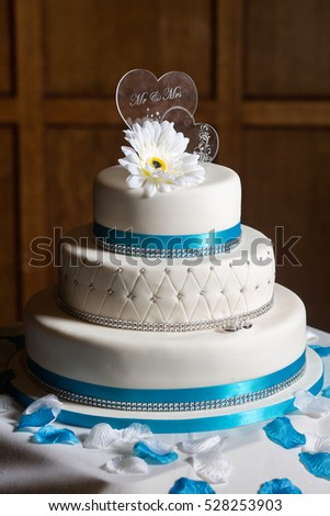 Tiered White Wedding Cake Against Traditional Stock Photo Edit Now