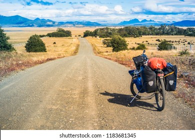 Tierra del Fuego / Argentina - February 21, 2018: Touring bike in a dirty road at south america.