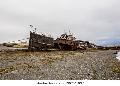 TIERRA DEL FUEGO, CHILE - February 2019: Shipwreck called Amadeo on the  coast of Magellan Strait, rusty warship wreck, Tierra Del Fuego, Chile