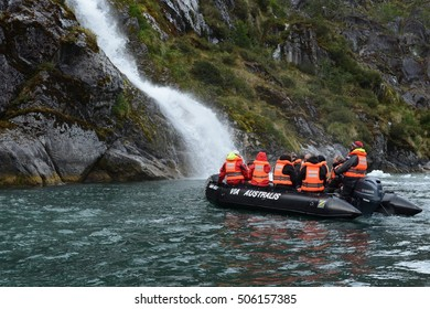 TIERRA DEL FUEGO, CHILE - NOVEMBER 20,2014:Tourists from the cruise ship near the waterfalls of the glacier Nena.